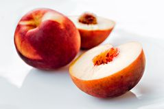 Peaches. On the white plate Stock Images