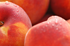 Peaches. Sweet, juicy peaches in the sunshine with water drops. Macro shot Stock Photo