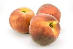 Peaches. Three peaches isolated on white Stock Photo