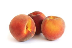 Peaches. Three peaches isolated over white background Royalty Free Stock Photo