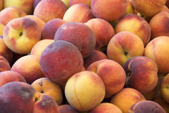 Peaches. A bunch of peaches - for background use Royalty Free Stock Photo