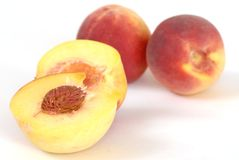 Peaches. Studio isolated on white background Royalty Free Stock Photo