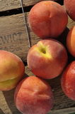 Peaches. On vinatge wooden crate Royalty Free Stock Image