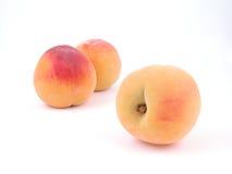 Peaches. Three peaches isolated on white Stock Image
