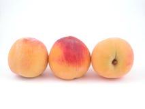 Peaches. Three peaches isolated on white Royalty Free Stock Photos