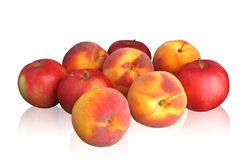 Peaches and apples on light background Royalty Free Stock Images
