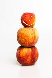 Peaches arranged like a happy snowman. On white Stock Image
