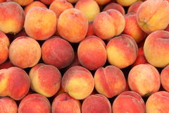 Peaches background. Bunch of peaches on a market Stock Image