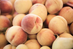 Peaches. A background of peaches at the marketplace Stock Images