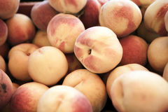 Peaches. A background of peaches at the marketplace Royalty Free Stock Image