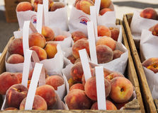 Peaches in Bags and Crates for Sale Royalty Free Stock Photo