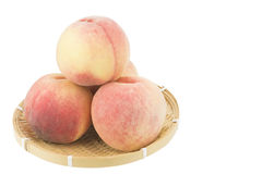 Peaches on bamboo basket Stock Photo