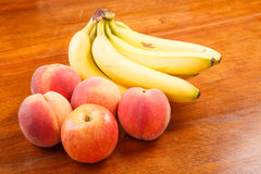 Peaches and Bananas with Apple Royalty Free Stock Photos