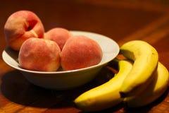 Peaches and Bananas in a Bowl Stock Photos