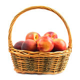 Peaches in basket Stock Photo