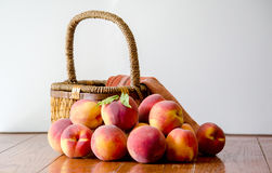 Peaches and basket Royalty Free Stock Image