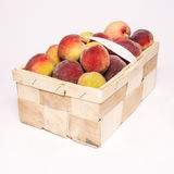 Peaches in basket. On white background Royalty Free Stock Image