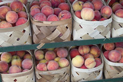 Peaches in Baskets Royalty Free Stock Photos