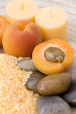 Peaches bath. With bath salt, stones and fresh fruits Stock Photography