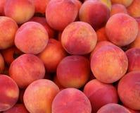 Peaches. Big pile of fresh organic ripe peaches Stock Photography
