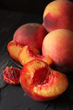 Peaches on black close-up Royalty Free Stock Photography