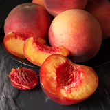 Peaches on black close-up Stock Images