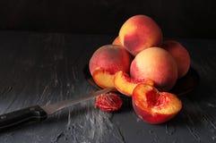 Peaches on black Royalty Free Stock Photos