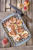 Peaches with blue cheese wrapped in bacon on square ceramic plat Royalty Free Stock Photography