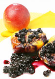 Peaches with blueberries Royalty Free Stock Photo