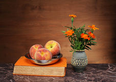 Peaches in a bowl and flowers Royalty Free Stock Photo