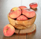 Peaches in a bowl Stock Photo