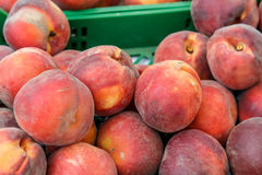 Peaches on boxes from a market Stock Image