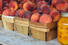 Peaches in boxes and mason jar Stock Image