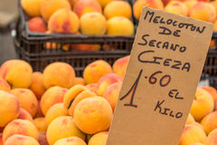 Peaches on boxes at street market (Torrevieja, Spain) Royalty Free Stock Photo