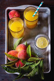 Peaches on branch and juice Stock Images