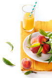 Peaches on branch and juice Stock Photos