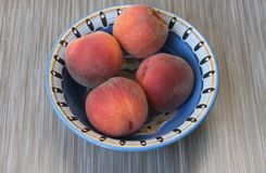 Peaches in a ceramic bowl royalty free stock images