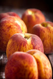 Peaches closeup. Peaches group closeup on wooden table Stock Photography