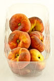 Peaches in container Stock Photography