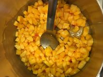 Peaches cooking with pectin, lemon juice, and butter Stock Photo