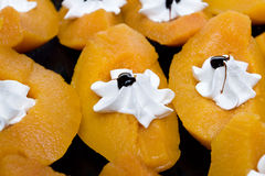 Peaches with cream and icing Stock Photography