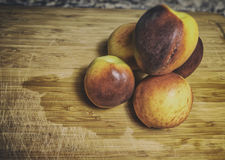 Peaches Cutting Board Royalty Free Stock Photo
