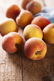 Peaches on desk Royalty Free Stock Photography
