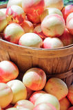 Peaches displayed in baskets Stock Photos
