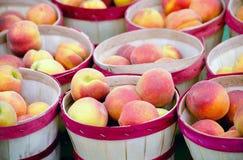 Peaches at a farmers market stock photo