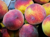 Peaches at farmers market Stock Images
