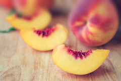 Peaches. Fresh harvested peaches on wooden background Royalty Free Stock Photos