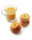 Peaches and fresh juice Royalty Free Stock Images