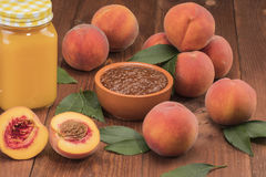 Peaches fresh new crop with leaves. With juice on the table Royalty Free Stock Photos