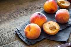 Peaches. Fresh Organic Peaches on rustic wooden background with copy space. Sweet summer peaches Royalty Free Stock Photography